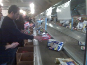 Volunteers sorting goods on the conveyor