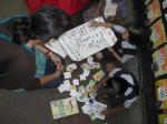 Akanksha kids showing their English work